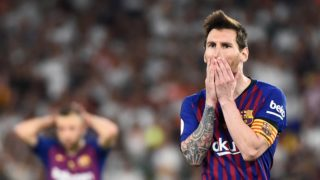 Barcelona's Argentinian forward Lionel Messi gestures after shooting a free kick during the 2019 Spanish Copa del Rey (King's Cup) final football match between Barcelona and Valencia on May 25, 2019 at the Benito Villamarin stadium in Sevilla. (Photo by JOSE JORDAN / AFP)