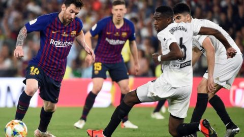 Barcelona's Argentinian forward Lionel Messi (L) vies with Valencia's French midfielder Geoffrey Kondogbia during the 2019 Spanish Copa del Rey (King's Cup) final football match between Barcelona and Valencia on May 25, 2019 at the Benito Villamarin stadium in Sevilla. (Photo by JOSE JORDAN / AFP)