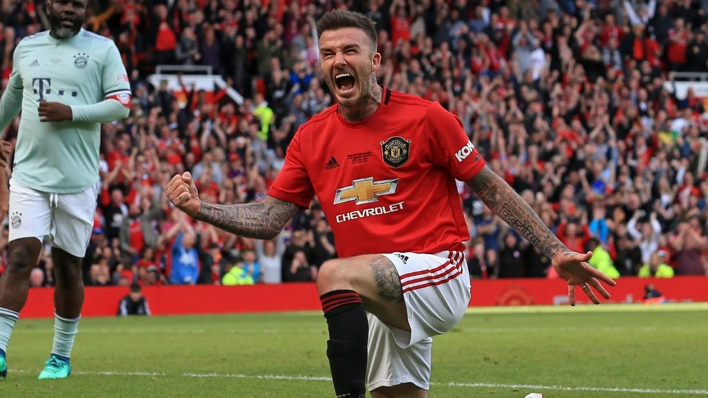 Manchester United '99 Legends player David Beckham celebrates after scoring their fifth goal during the Treble Reunion 20th anniversary football match between Manchester United '99 Legends and FC Bayern Legends at Old Trafford in Manchester, north-west England on May 26, 2019. (Photo by Lindsey PARNABY / AFP)