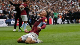 Aston Villa's English midfielder Jack Grealish celebrates after winning the English Championship play-off final football match between Aston Villa and Derby County at Wembley Stadium in London on May 27, 2019. (Photo by Adrian DENNIS / AFP) / NOT FOR MARKETING OR ADVERTISING USE / RESTRICTED TO EDITORIAL USE