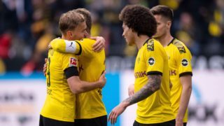 11 May 2019, North Rhine-Westphalia, Dortmund: Soccer: Bundesliga, Borussia Dortmund - Fortuna Düsseldorf, 33rd matchday. Dortmund's Marcel Schmelzer (l-r), Lukasz Piszczek, Axel Witsel and Julian Weigl cheer after the game. Photo: Marius Becker/dpa - IMPORTANT NOTE: In accordance with the requirements of the DFL Deutsche Fußball Liga or the DFB Deutscher Fußball-Bund, it is prohibited to use or have used photographs taken in the stadium and/or the match in the form of sequence images and/or video-like photo sequences.