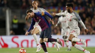 (L-R) Fabinho of Liverpool FC, Lionel Messi of FC Barcelona, Joe Gomez of Liverpool FC during the UEFA Champions League semi final match between FC Barcelona and Liverpool FC at Camp Nou on May 01, 2019 in Barcelona, Spain(Photo by VI Images via Getty Images)