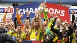 BIRMINGHAM, ENGLAND - MAY 05: Grant Hanley of Norwich City lifts the Championship trophy following the Sky Bet Championship game between Aston Villa and Norwich City at Villa Park on May 05, 2019 in Birmingham, England. (Photo by Malcolm Couzens/Getty Images)