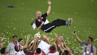 Qatar's coach Felix Sanchez is thrown in the air as his team celebrates their win in the 2019 AFC Asian Cup final football match between Japan and Qatar at the Zayed Sports City Stadium in Abu Dhabi on February 1, 2019. (Photo by Khaled DESOUKI / AFP)