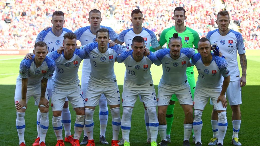 SLovakia players (back row L-R) Slovakia's defender Milan Skriniar, Slovakia's defender Denis Vavro, Slovakia's defender David Hancko, Slovakia's goalkeeper Martin Dubravka and Slovakia's midfielder Juraj Kucka, (front row L-R) Slovakia's midfielder Ondrej Duda, Slovakia's midfielder Albert Rusnak, Slovakia's defender Peter Pekarik, Slovakia's midfielder Robert Mak, Slovakia's midfielder Marek Hamsik and Slovakia's midfielder Stanislav Lobotka pose for a pre-game photograph before the UEFA Euro 2020 Group E qualification football match between Wales and Slovakia at Cardiff City Stadium in Cardiff on March 24, 2019. (Photo by Geoff CADDICK / AFP)