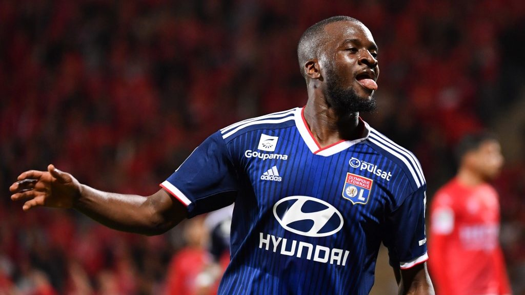 Lyon's French forward Tanguy NDombele Alvaro celebrates after scoring a goal during the French L1 football match between Nimes Olympique and Olympique Lyonnais (OL) at the Costieres stadium in Nimes, on May 24, 2019. (Photo by Pascal GUYOT / AFP)