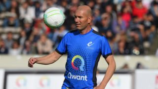 Real Madrid's French coach Zinedine Zidane warms up ahead of a charity game with football and rugby legends on May 27, 2019 in Bordeaux, southwestern France. (Photo by NICOLAS TUCAT / AFP)