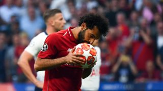 Liverpool's Egyptian forward Mohamed Salah kisses the ball prior to shooting a penalty kick to score the opening goal during the UEFA Champions League final football match between Liverpool and Tottenham Hotspur at the Wanda Metropolitano Stadium in Madrid on June 1, 2019. (Photo by GABRIEL BOUYS / AFP)