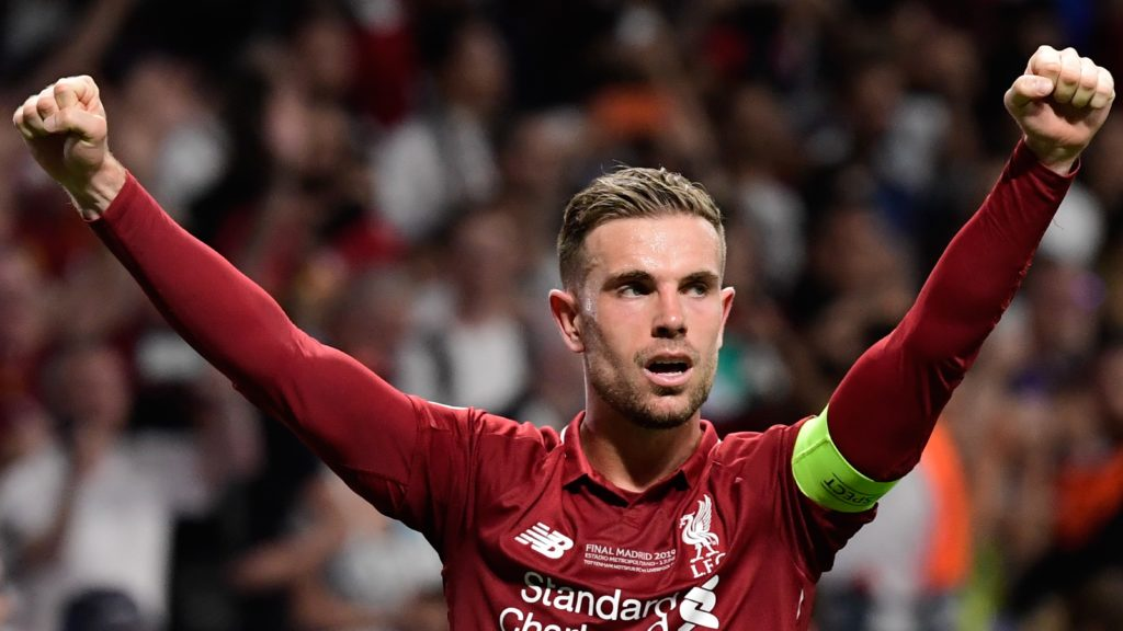 Liverpool's English midfielder Jordan Henderson reacts after winning the UEFA Champions League final football match between Liverpool and Tottenham Hotspur at the Wanda Metropolitano Stadium in Madrid on June 1, 2019. (Photo by JAVIER SORIANO / AFP)