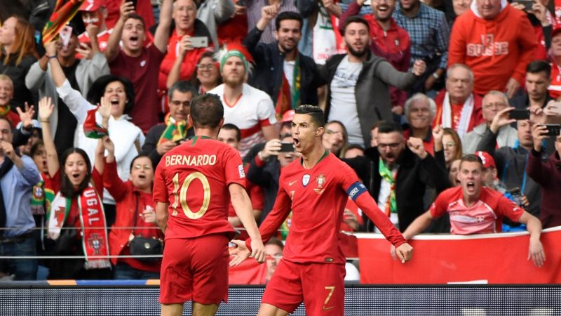 Portugal's forward Cristiano Ronaldo (R) celebrates after scoring a goal during the UEFA Nations League semi-final football match between Portugal and Switzerland at the Dragao stadium in Porto on June 5, 2019. (Photo by MIGUEL RIOPA / AFP)