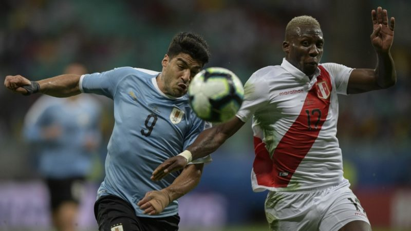 Uruguay's Luis Suarez (L) and Peru's Luis Advincula run for the ball during their Copa America football tournament quarter-final match at the Fonte Nova Arena in Salvador, Brazil, on June 29, 2019. (Photo by Juan MABROMATA / AFP)