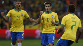 Brazil's Philippe Coutinho (C) celebrates with teammates after scoring during a friendly football match between Brazil and Honduras at the Beira Rio Stadium in Porto Alegre, on June 9, 2019, ahead of Brazil 2019 Copa America. (Photo by Jeferson Guareze / AFP)