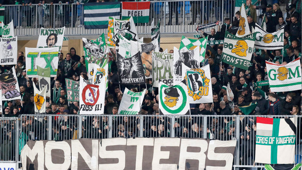 BUDAPEST, HUNGARY - MARCH 9: The ultra supporters of Ferencvarosi TC (called Green Monsters) lift up banners during the Hungarian OTP Bank Liga match between MTK Budapest and Ferencvarosi TC at Nandor Hidegkuti Stadium on March 9, 2019 in Budapest, Hungary. (Photo by Laszlo Szirtesi/Getty Images)