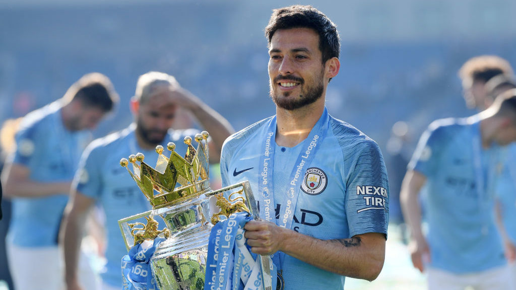 BRIGHTON, ENGLAND - MAY 12: David Silva of Manchester City celebrates with the Premier League Trophy after winning the title following the Premier League match between Brighton & Hove Albion and Manchester City at American Express Community Stadium on May 12, 2019 in Brighton, United Kingdom. (Photo by  Shaun Botterill/Getty Images)