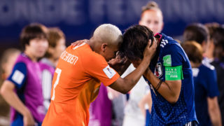 RENNES, FRANCE - JUNE 25: Shanice Van De Sanden of Netherlands (L) supports Saki Kumagai of Japan (R) who cries out after being defeated during the 2019 FIFA Women's World Cup France Round Of 16 match between Netherlands and Japan at Roazhon Park on June 25, 2019 in Rennes, France. (Photo by Marcio Machado/Getty Images)