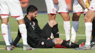 28 June 2019, Egypt, Suez: Tunisia's goalkeeper Mouez Hassen lies on the pitch during the 2019 Africa Cup of Nations Group E soccer match between Tunisia and Mali at Suez Sports Stadium. Photo: Oliver Weiken/dpa