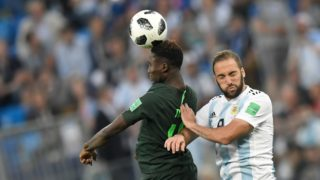 Nigeria's forward Kelechi Iheanacho (L) and Argentina's forward Gonzalo Higuain compete for the ball during the Russia 2018 World Cup Group D football match between Nigeria and Argentina at the Saint Petersburg Stadium in Saint Petersburg on June 26, 2018. (Photo by GABRIEL BOUYS / AFP) / RESTRICTED TO EDITORIAL USE - NO MOBILE PUSH ALERTS/DOWNLOADS