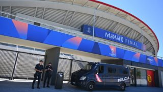 Spanish police officers stand guard outside the Wanda Metropolitan Stadium in Madrid on May 30, 2019 ahead of the UEFA Champions League final football match between Liverpool and Tottenham Hotspur on June 1. (Photo by GABRIEL BOUYS / AFP)