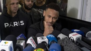 Brazil's star striker Neymar gives the thumb up as he leaves a Police Station after giving a statement to police for posting intimate WhatsApp messages with Najila Trindade Mendes de Souza, who has accused of rape, on social media, at the Internet Crime Special Police Unit in Rio de Janeiro, Brazil on June 6, 2019. (Photo by Mauro Pimentel / AFP)