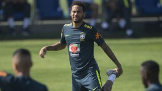 Brazil's footballer Neymar stretches during a training session of the national team at the Granja Comary sport complex in Teresopolis, Brazil, on June 1, 2019 ahead of the Copa America football tournament. (Photo by Mauro PIMENTEL / AFP)