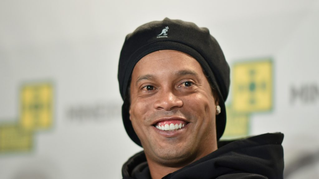 Brazilian former footballer Ronaldinho Gaucho attends a press conference during a ceremony to stamp his footprints at the Mineirao Stadium's football museum in Belo Horizonte, Minas Gerais state, Brazil, on May 21, 2018. - Ronaldinho Gaucho was awarded Best FIFA Men's Player twice, in 2004 and 2005. (Photo by DOUGLAS MAGNO / AFP)