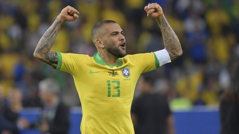 Brazil's Dani Alves celebrates after defeating Peru to win the Copa America football tournament at Maracana Stadium in Rio de Janeiro, Brazil, on July 7, 2019. (Photo by Luis Acosta / AFP)