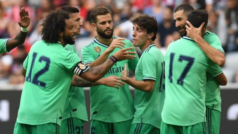 Real Madrid's French forward Karim Benzema (R) celebrates scoring with his team-mates during the Audi Cup football match for third place between Real Madrid and Fenerbahce in Munich, on July 31, 2019. (Photo by Christof STACHE / AFP)