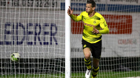 ROEDINGHAUSEN, GERMANY - APRIL 03: Balint Bajner of Dortmund celebrates after scoring his team`s first goal during the Regionalliga West match between SV Roedinghausen and Borussia Dortmund II at Haecker-Wiehenstadion on April 03, 2018 in Roedinghausen, Germany. (Photo by TF-Images/Getty Images)
