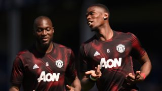 Manchester United's Belgian forward Romelu Lukaku (L) and Manchester United's French midfielder Paul Pogba (R) warm up before the English Premier League football match between Everton and Manchester United at Goodison Park in Liverpool, north west England on April 21, 2019. (Photo by Oli SCARFF / AFP) / RESTRICTED TO EDITORIAL USE. No use with unauthorized audio, video, data, fixture lists, club/league logos or 'live' services. Online in-match use limited to 120 images. An additional 40 images may be used in extra time. No video emulation. Social media in-match use limited to 120 images. An additional 40 images may be used in extra time. No use in betting publications, games or single club/league/player publications. /
