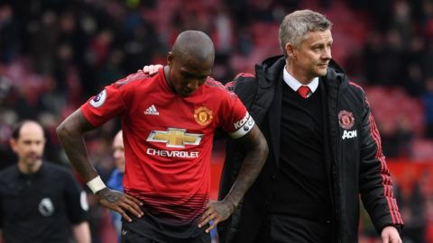 Manchester United's Norwegian manager Ole Gunnar Solskjaer (R) puts an arm around Manchester United's English defender Ashley Young (L) at the end of the English Premier League football match between Manchester United and Chelsea at Old Trafford in Manchester, north west England, on April 28, 2019. (Photo by Paul ELLIS / AFP) / RESTRICTED TO EDITORIAL USE. No use with unauthorized audio, video, data, fixture lists, club/league logos or 'live' services. Online in-match use limited to 120 images. An additional 40 images may be used in extra time. No video emulation. Social media in-match use limited to 120 images. An additional 40 images may be used in extra time. No use in betting publications, games or single club/league/player publications. /