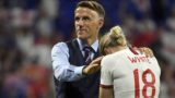 England's coach Phil Neville (C) comforts England's forward Ellen White at the end of the France 2019 Women's World Cup semi-final football match between England and USA, on July 2, 2019, at the Lyon Satdium in Decines-Charpieu, central-eastern France. (Photo by Philippe DESMAZES / AFP)