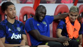 Manchester United's Romelu Lukaku (C) sits on the bench with teammates during the International Champions Cup football match between Manchester United and Inter Milan in Singapore on July 20, 2019. (Photo by Roslan RAHMAN / AFP)