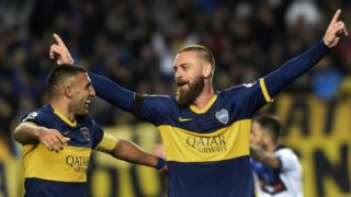 """Photo released by Noticias Argentinas of Boca Junior's defender Italian Daniele De Rossi (R) celebrating next to  forward Ramon Abila after scoring against Almagro during the Copa Argentina football match at Ciudad de La Plata stadium in La Plata, Buenos Aires on August 13, 2019. (Photo by STR / NOTICIAS ARGENTINAS / AFP) / - Argentina OUT / RESTRICTED TO EDITORIAL USE - MANDATORY CREDIT """"AFP PHOTO / NOTICIAS ARGENTINAS / AGLAPLATA  """" - NO MARKETING - NO ADVERTISING CAMPAIGNS - DISTRIBUTED AS A SERVICE TO CLIENTS"""