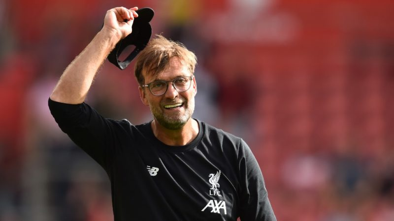 Liverpool's German manager Jurgen Klopp celebrates on the pitch on the final whistle in the English Premier League football match between Southampton and Liverpool at St Mary's Stadium in Southampton, southern England on August 17, 2019. - Liverpool won the game 2-1. (Photo by Glyn KIRK / AFP) / RESTRICTED TO EDITORIAL USE. No use with unauthorized audio, video, data, fixture lists, club/league logos or 'live' services. Online in-match use limited to 120 images. An additional 40 images may be used in extra time. No video emulation. Social media in-match use limited to 120 images. An additional 40 images may be used in extra time. No use in betting publications, games or single club/league/player publications. /