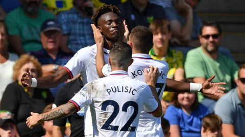 Chelsea's English striker Tammy Abraham (C) celebrates with teammates after scoring his second goal, Chelsea's third during the English Premier League football match between Norwich City and Chelsea at Carrow Road in Norwich, eastern England on August 24, 2019. (Photo by Daniel LEAL-OLIVAS / AFP) / RESTRICTED TO EDITORIAL USE. No use with unauthorized audio, video, data, fixture lists, club/league logos or 'live' services. Online in-match use limited to 120 images. An additional 40 images may be used in extra time. No video emulation. Social media in-match use limited to 120 images. An additional 40 images may be used in extra time. No use in betting publications, games or single club/league/player publications. /
