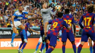 MIAMI, FLORIDA - AUGUST 07: Neto #13 of FC Barcelona makes a save on a corner kick against SSC Napoli during the first half of a pre-season friendly match at Hard Rock Stadium on August 07, 2019 in Miami, Florida.   Michael Reaves/Getty Images/AFP