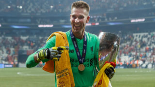 ISTANBUL, TURKEY - AUGUST 14: Goalkeeper Adrian of Liverpool FC celebrates with the trophy after winning the UEFA Super Cup match between FC Liverpool and FC Chelsea at Vodafone Park on August 14, 2019 in Istanbul, Turkey. (Photo by TF-Images/ Getty Images)