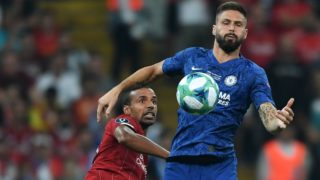Liverpool's Brazilian midfielder Fabinho (L) vies for the ball with Chelsea's French striker Olivier Giroud during the UEFA Super Cup 2019 football match between FC Liverpool and FC Chelsea at Besiktas Park Stadium in Istanbul on August 14, 2019. (Photo by OZAN KOSE / AFP)