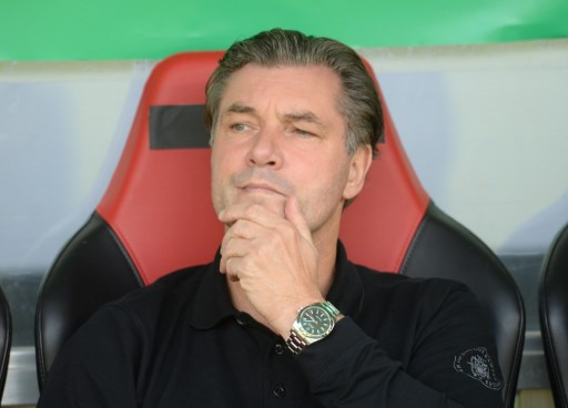 Dortmund's sports director Michael Zorc sits on the bench ahead of the German Soccer Association (DFB) Cup first-round soccer match between 1. FC Rielasingen-Arlen and Borussia Dortmund in the Schwarzwald Stadium in Freiburg, Germany, 12 August 2017. The club has announced that Ousmane Dembele, the young attacking midfielder whose breakout season at the club has led to him being linked with clubs across Europe including Barcelona, will remain suspended from the team 'until further notice'. The announcement was made on Sunday morning at a conference with Dortmund's sports director Michael Zorc, manager Peter Bosz and CEO Hans-Joachim Watzke. Photo: Patrick Seeger/dpa