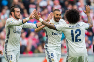 BILBAO, SPAIN - MARCH 18:  Karim Benzema of Real Madrid celebrates with his teammate Gareth Bale and Marcelo Vieira da Silva of Real Madrid after scoring the opening goal during the La Liga match between Athletic Club Bilbao and Real Madrid at San Mames Stadium on March 18, 2017 in Bilbao, Spain.  (Photo by Juan Manuel Serrano Arce/Getty Images)