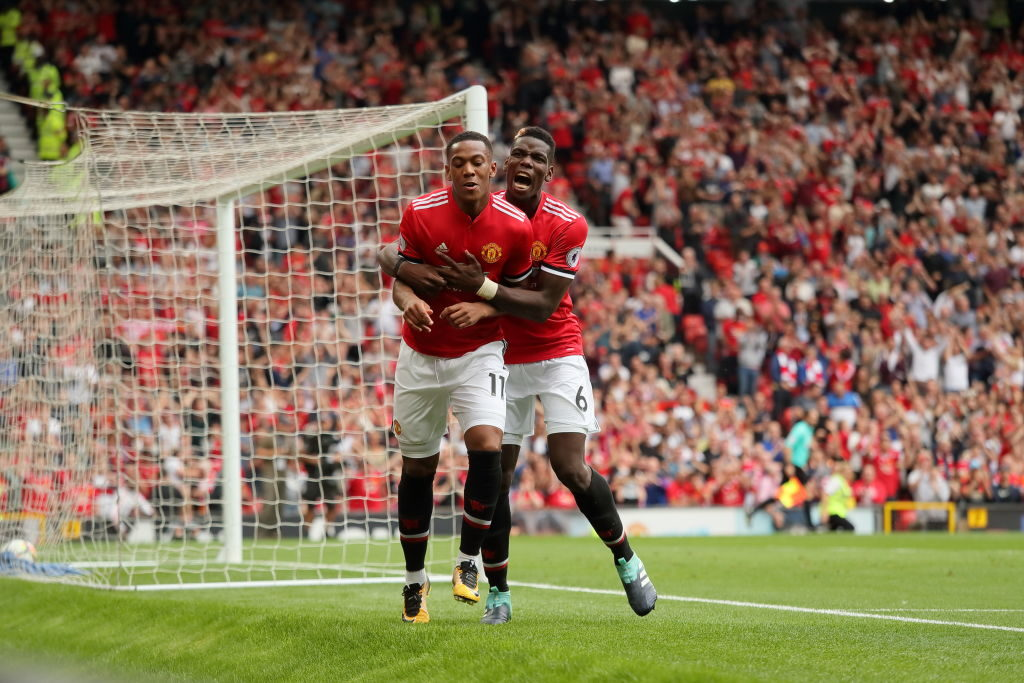 MANCHESTER, ENGLAND - AUGUST 13: Anthony Martial of Manchester United celebrates after scoring a goal to make it 3-0 with Paul Pogba during the Premier League match between Manchester United and West Ham United at Old Trafford on August 13, 2017 in Manchester, England. (Photo by Matthew Ashton - AMA/Getty Images)