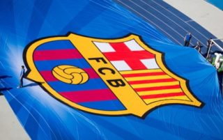 The emblem of FC Barcelona is stretched for the Champions League final in the Olympic stadium in Berlin, Germany, 04 June 2015. The UEFAChampions League final between Juventus FC and FC Barcelona takes place at the Olympic Stadium in Berlin on 06 June 2015. Photo:KAYNIETFELD/dpa