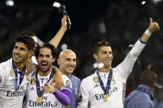 Marco Asensio, Isco and Cristiano Ronaldo of Real Madrid during the award ceremony the UEFA Champions League Final between Juventus and Real Madrid at National Stadium of Wales on June 3, 2017 in Cardiff, Wales. (Photo by Matteo Ciambelli/NurPhoto)