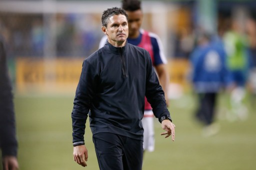 SEATTLE, WA - MARCH 08: Head coach Jay Heaps of the New England Revolution walks off the pitch after the match against the Seattle Sounders FC at CenturyLink Field on March 8, 2015 in Seattle, Washington. The Sounders defeated the Revolution 3-0.   Otto Greule Jr/Getty Images/AFP