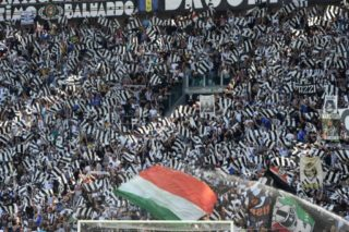 TURIN, ITALY - MAY 21: Fans of Juventus wave flags during Italian Serie A football match between Juventus and FC Crotone at Juventus Stadium in Turin, Italy on May 21, 2017. Pier Marco Tacca / Anadolu Agency