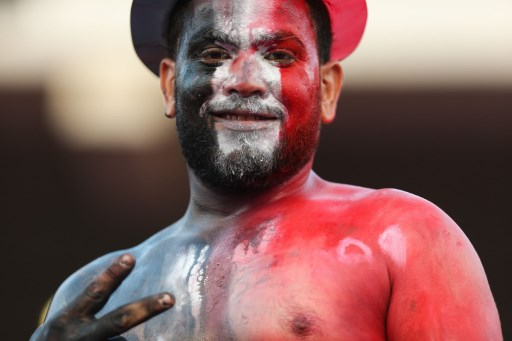 ALEXANDRIA, EGYPT - OCTOBER 8: A supporter of Egypt with his face painted in the colours of Egyptian flag gestures as he poses for a photo during the 2018 World Cup Africa Qualifying match between Egypt and Congo at the Borg el-Arab Stadium in Alexandria, Egypt on October 8, 2017. Fared Kotb / Anadolu Agency