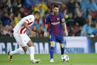 (L-R) Vadis Odjidja of Olympiacos , Lionel Messi of FC Barcelona during the UEFA Champions League group D match between FC Barcelona and Olympiacos on October 18, 2017  at the Camp Nou stadium in Barcelona, Spain.(Photo by VI Images via Getty Images)