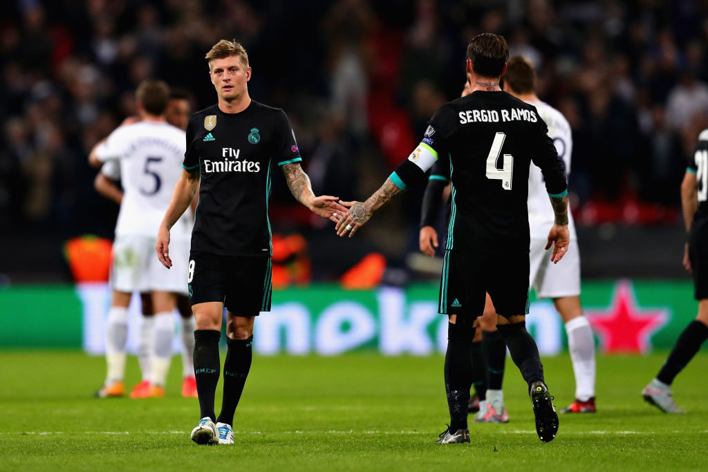 LONDON, ENGLAND - NOVEMBER 01: Toni Kroos of Real Madrid shakes hands with teammate Sergio Ramos after the UEFA Champions League group H match between Tottenham Hotspur and Real Madrid at Wembley Stadium on November 1, 2017 in London, United Kingdom.  (Photo by Chris Brunskill Ltd/Getty Images)