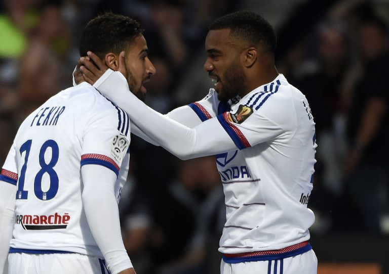 Lyon's French forward Nabil Fekir (L) is congratuled by teamate Lyon's French forward Alexandre Lacazette (R) after scoring during the French L1 football match Olympique Lyonnais against FC Girondins de Bordeaux , on May 16, 2015  at the Gerland stadium in Lyon, Southeastern France.                                    AFP PHOTO/PHILIPPE DESMAZES / AFP PHOTO / PHILIPPE DESMAZES