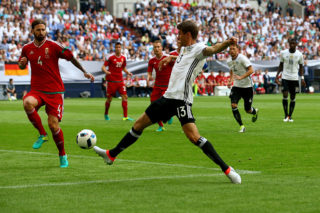 GELSENKIRCHEN, GERMANY - JUNE 04: Tamas Kadar of Hungary (L) challenges Thomas Mueller of Germany during the International Friendly match between Germany and Hungary at Veltins-Arena on June 4, 2016 in Gelsenkirchen, Germany.  (Photo by Christof Koepsel/Bongarts/Getty Images)